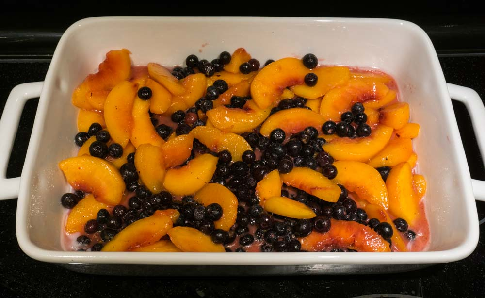 peaches blueberries in baking dish